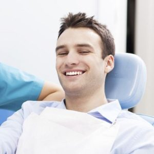 Man smiling before he gets his wisdom teeth extracted