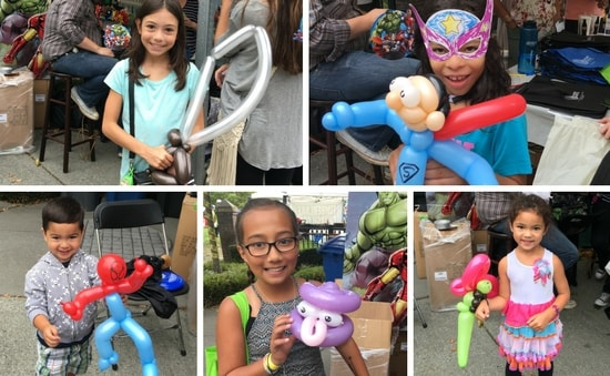 Kids pose with their balloon art at the Discovery Dental booth at Highlands Day 2016
