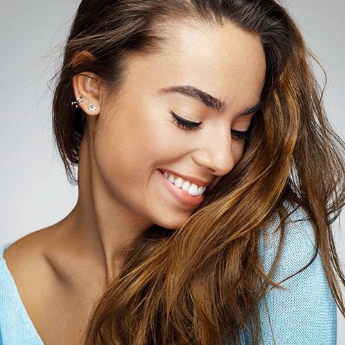 Smiling woman from dental bonding