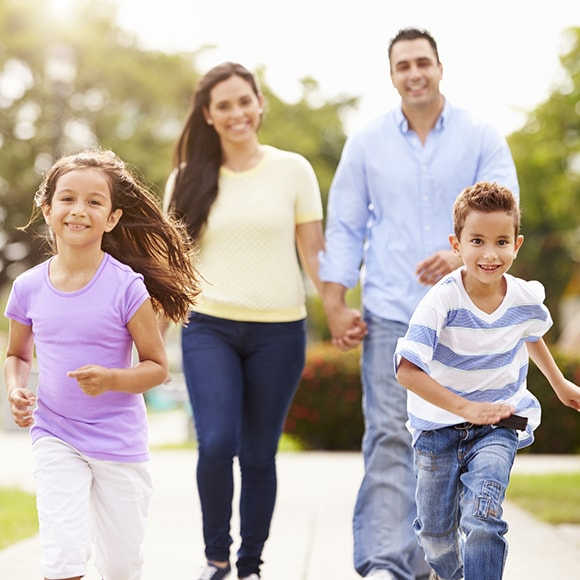A loving family running and having fun, which is our goal when it comes to family dentistry in Issaquah, WA