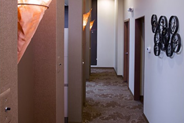Office tour of Discovery Dental. Here is the hallway to one of the exam rooms.