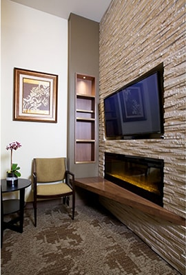 Office tour of Discovery Dental. Here is the front office with a TV and fireplace.