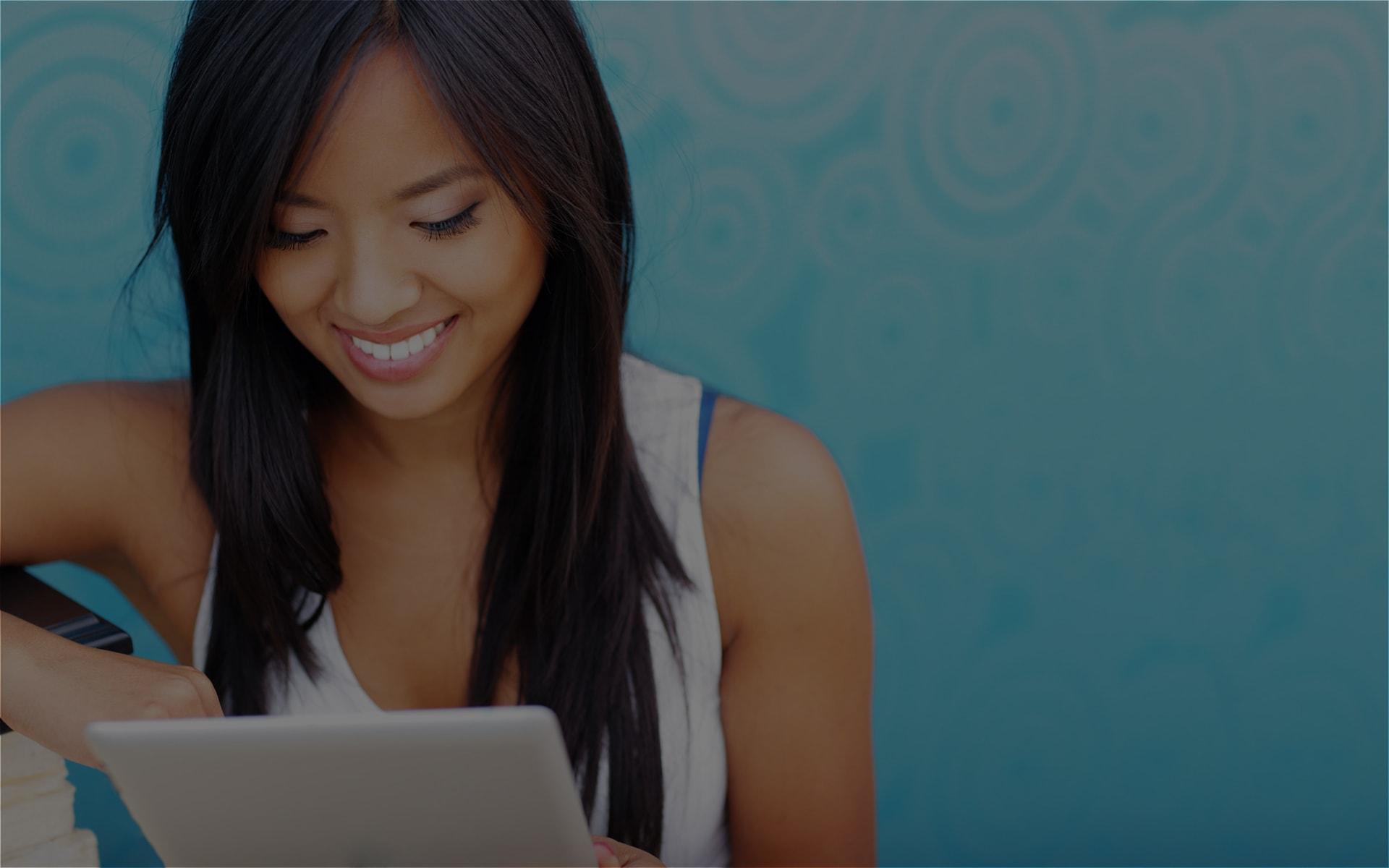 Image of woman looking at an iPad